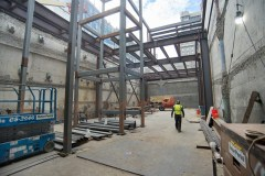 A lattice of steel rises from the floor of the north station entrance structure, where stairs and elevators will eventually be installed.